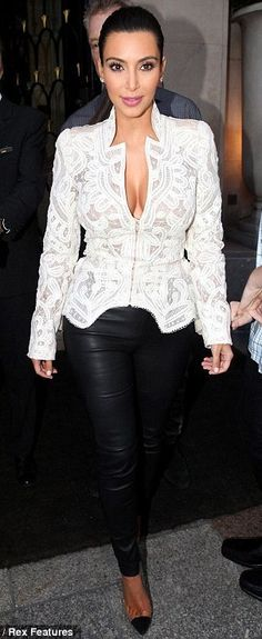 Kim Kardashian in a white Alexander McQueen crochet embroidered silk-organza jacket with black leather pants and Christian Louboutin Illusion pumps.