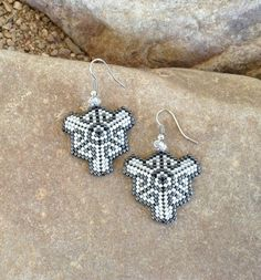Here are some gunmetal gray and light gray triangle earrings. They are light weight and fun to wear They are 2 inches long from the top of the french hook and 1 1/4 inches wide. Made with glass Delica beads. The stitch used is Peyote Stitch. These would be a great gift for someone or