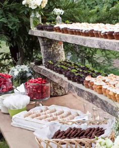 The groom and his friend created this wooden display, which boasted five types of cupcakes, as well as summer berry and stone fruit shortcakes.