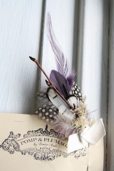 Andersen boutonniere in purple feathers, moss and birch branch