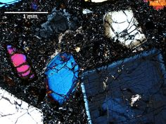 A microscopic image of crystals from the youngest volcanoes in eastern North America. The image focuses on a clinopyroxene crystal in a 1-millimeter slice of basalt from Virginia.