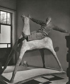 Italian sculptor, Marino MARINI, in his studio on one of his horses. Milan Italy…