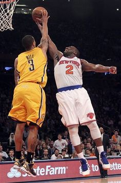 Raymond Felton (2) goes up past Indiana Pacers George Hill