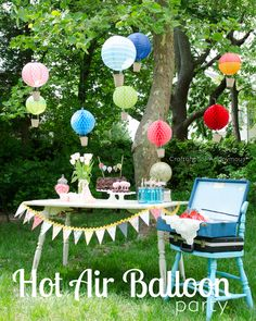 Hot Air Balloon Birthday party. Love this theme! Those hot air balloons made with paper lanterns are so awesome!