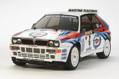 The storied Lancia Delta HF integrale. Tamiya has recreated this vehicle in a four wheel driver version. Clad in the instantly recognizable Martini Racing livery, this Lancia is reproduced to down to the smallest part. Get ready to challenge your rivals in a backyard rally!    –<em>Bill@ChoiceGear</em>