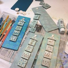 Sue Davis is painting mixed media clay tile assemblages.
