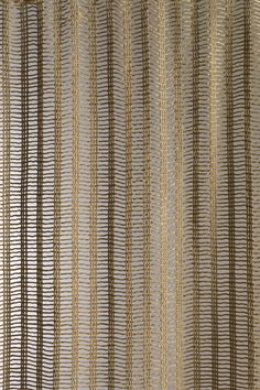 "German-American textile designer Anni Albers worked with Knoll from 1957 into the 1970s. Her Rail textile was introduced in 1962. ""Albers had experimented with weaving gauze since the 1920s,"" Makovsky says. ""Here she twisted threads so that it has these wide opens spaces in the textile itself. In the 1950s she wrote about using loose and rigid textiles as space dividers, which Florence Knoll had begun doing in showrooms."
