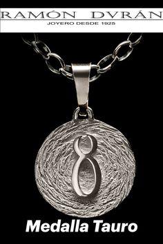 ¿Buscas una medallita con tu signo del zodiaco #tauro♉ Medalla de 19 mm realizada en plata de Ley, con terminación mate y brillo. Es del signo Tauro. Esta joya se entregara con estuche y un pequeño pergamino con las características de tu horóscopo. Te hacemos el 15% de descuento durante el reinado de #tauro♉ 100% fabricados en 🇪🇸 España. ✅Ramón Durán Joyero 📫 Calle Donoso Cortés, 85, Madrid ☎️ 91 549 33 64 ⠀ #joyasduran #signosdelzodiaco #joyeriademoda #horoscoposdeplata #joyastauro Madrid, Reign Bash, Copper, Sterling Silver, Astrology Signs, Pergamino, Silver Jewellery, Zodiac Signs, Fashion Jewelry