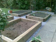 raised bed for vegetables using sleepers by GardenFocus, via Flickr