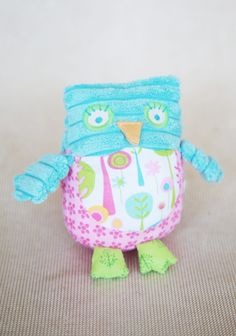 Olivia The Owl Rattle 14.99 at shopruche.com. The softest and sweetest playmate, this plush owl rattle is crafted in a blue ribbed knit with woven pink floral details. All ages. Surface wash.100% Polyester, Fill: 100% Polyester