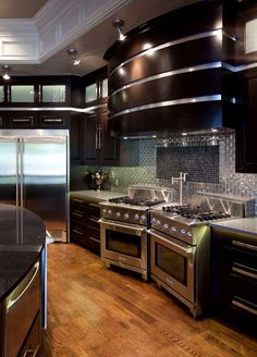 Love the cabinets, backsplash and flooring. Don't need two stoves, though, rather have a wall oven and microwave combo.
