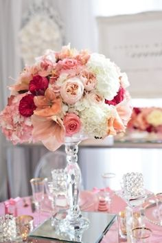 Different tones of pink flower arrangement for wedding table. LMC