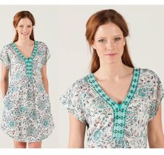 So easy to wear, this lightweight dress is a hit with it's pretty print, embroidered neckline and curved hem.