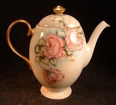 You are bidding on one Vintage Limoges France China Hand Painted Pink Roses Decorated Tea Pot in Excellent Condition with no chips, cracks, repairs, etc. The piece is not marked. The beautiful hand p
