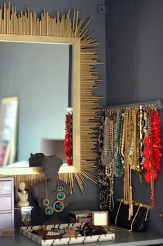 hang your necklaces on little hooks to keep them organized.