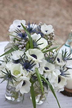 White anemones, thistle. Would look great with baby blue eucalyptus                                                                                                                                                     More