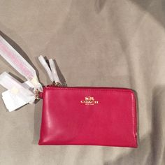 NWT Coach corner-zip red leather wristlet NWT Coach red leather double-zip wristlet. Approximately 6.5 x 3.75 x 1 inches. Includes interior slot for cards. Originally $85. Coach Bags Clutches & Wristlets