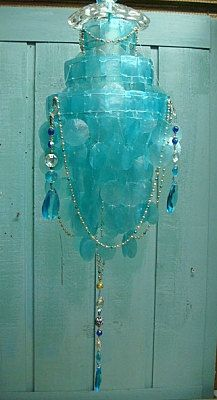 One of a kind turquoise capiz chandelier by CastawaysHall.