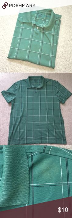 """Van Heusen Green Polo Window pane green polo with white and black accents in size large. Some fabric piling and some spots of discoloration (see photos). Armpit to armpit is 21"""" and length is 27"""". Van Heusen Shirts Polos"""