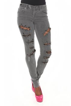 Edgy! Ripped, pinned skinny jeans. I don't know why I love them but I do. Hot Topic and only $39.50.
