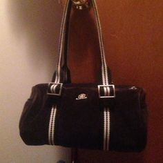 """JLo velvet sporty purse Black and white sporty soft velvet sport purse. 10"""" long, 5"""" D and 5"""" w. Very clean and early used. A pocket on each end. Hot pink interior with a zipper pocket and 3 other pockets inside (cell phone, 3 lipstick and 1 pen size). Jennifer Lopez Bags"""