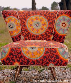 Restored Mid Century Swivel Slipper Chair, reupholstered in Tribal- Sunset via Etsy.