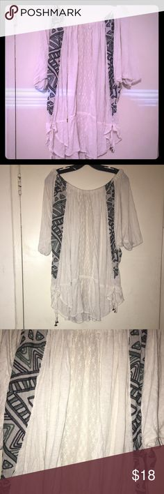 Free People brand shirt size large Free People brand shirt. Shirt is a size large. Reminds you of the boho style. Lace going doe the middle the strings on both sides near the bottom. In good condition Free People Tops