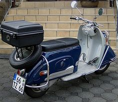1956 Heinkel Tourist. This scooter had a frame-mounted engine and a swingarm with an integral chain enclosure.