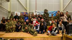 U.S. Marines and Sailors with the Black Sea Rotational Force team up with U.S. Soldiers to participate in a Christmas holiday event for the local Romanian children to strengthen community relations.