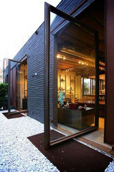 porte coulissante en verre, baie vitrée pour une maison plain pied