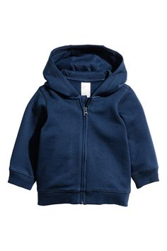 Dark blue. CONSCIOUS. Jacket in organic cotton sweatshirt fabric. Jersey-lined hood, zip at front, and ribbing at cuffs and hem. Brushed inside.