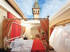 An open-air bedroom in Lombardy, Italy.  Upside?  A button closes the roof back up if it should happen to rain.