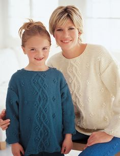 Free knitting pattern for Just Like Mom Pullover - This long-sleeved pullover sweater from Patons features elegant cables with pretty flower-like bobbles. Sizes for 6, 8, and 10 years and adult XS to XL.