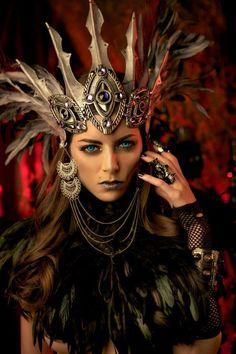 Beautiful costume and headdress. Love the eyes.
