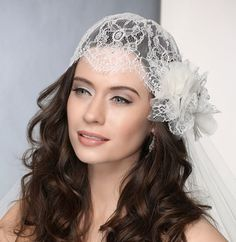 Bel Aire Bridal Lace Cap 6364 - Beaded Chantilly lace cap A vintage-inspired Chantilly lace cap adds creative detail to your personal style! Featuring lovely pearls and glistening rhinestones, this forget-me-not topper works in dramatic harmony with a lace flower and fashionable veil. Available in ivory. Shown with 2-tier knee length rolled edge veil (V7198) andour lace and organza flower clip (6353).