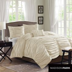 @Overstock.com - Madison Park Newport Cotton 4-piece Duvet Cover Set - Add a romantic touch to your bedroom decor with this gorgeous rouched cotton duvet cover set. The billowy woven fabric has a thread count of 180 for ultra-soft feel, and it's completely machine washable for easy cleaning. The duvet is also reversible.  http://www.overstock.com/Bedding-Bath/Madison-Park-Newport-Cotton-4-piece-Duvet-Cover-Set/7910745/product.html?CID=214117 $89.99