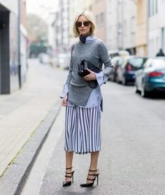 Layer a lightweight knit over your button-down, and finish the look with a striped skirt.