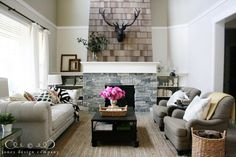 living room with stone/shingled fireplace
