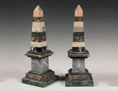 "PAIR OF STONE OBELISKS - Early 20th c. Roman Form Obelisks with integral plinths, constructed in layers of various colored marbles - Dim: 12 1/4"" tall."