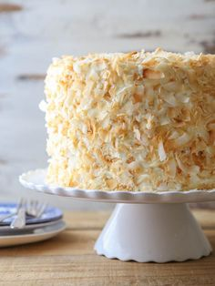 This southern coconut layer cake has light and tender coconut cake layers, a creamy coconut filling, and coconut cream cheese frosting. It's a coconut lover's dream come true! Southern Coconut Cake Recipe, Best Coconut Cake Recipe, Coconut Cake From Scratch, Mini Cakes, Cupcake Cakes, Cupcakes, Cake Recipes, Dessert Recipes, Frosting Recipes