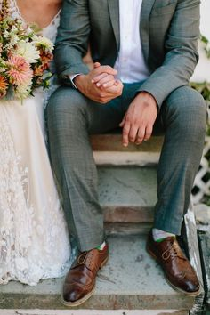 Beautiful photo for your wedding day! We adore the details in her dress and we love his suit!