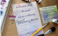 Our Watercolour Storm Wedding Invitations feature a fun selection of fonts and font sizes on a full background of blended watercolour patterns.