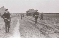 Members of the Dutch Resistance assisting American paratroopers during Market-Garden.