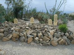 Boothill Cemetary,Tombstone, Arizona  -contains the bodies of three men killed in the Gunfight At the OK Corral - Billy Clanton,Tom McLaury, & Frank McLaury - ghostly cowboys with guns drawn are seen, light anomolies