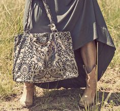 ainsley bag - filigree empire black print how could you stalk the streets or cruise the malls without this elegant handbag on your arm?  hit that high-powered business meeting with the most stunning workbag/laptop bag in the room!