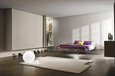 Fluttua Bed by Lago with a single central support and courtine Wardrove! #armaris #mobles #granollers