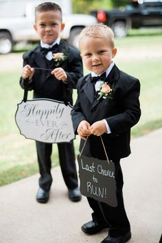 "Adorable ring bearer idea - ring bearers in matching black tuxes with black bow ties + peach boutonnieres carrying signs that read ""happily ever after"" + ""last chance to run"" {Rockhill Studio}"