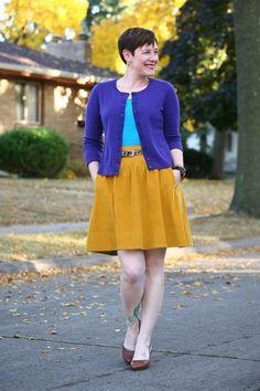 Already Pretty outfit featuring purple cardigan, turquoise tank top, leopard belt, mustard skirt, cognac pumps