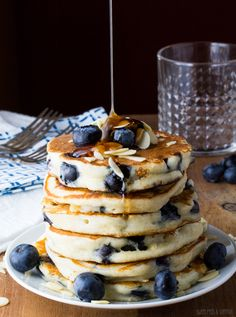 Extra Fluffy Blueberry Almond Pancakes- greek yogurt makes these pancakes so thick and fluffy!   sweetpeasandsaffron.com