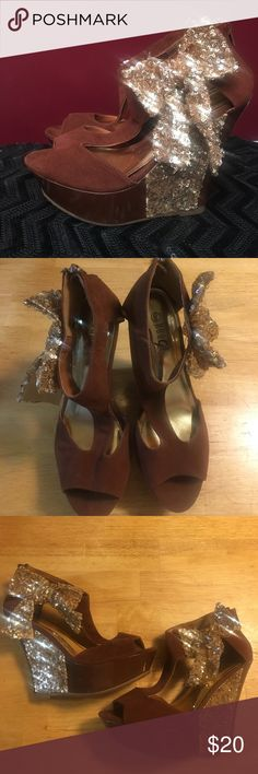 Brown & Gold Bow Wedges A pair of brown wedge shoes with a sequin gold bow by Rouge. Size 9. Worn once. The white on the bottom of the wedge is from the price sticker. Perfect for fancy holiday dinners! Smoke free home. Rogue Shoes Wedges